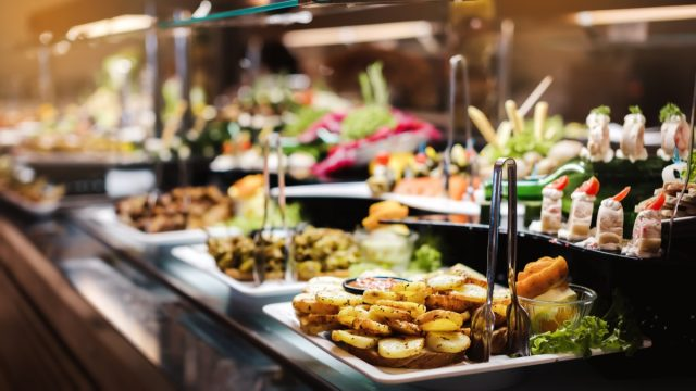buffet restaurant warming trays full of food