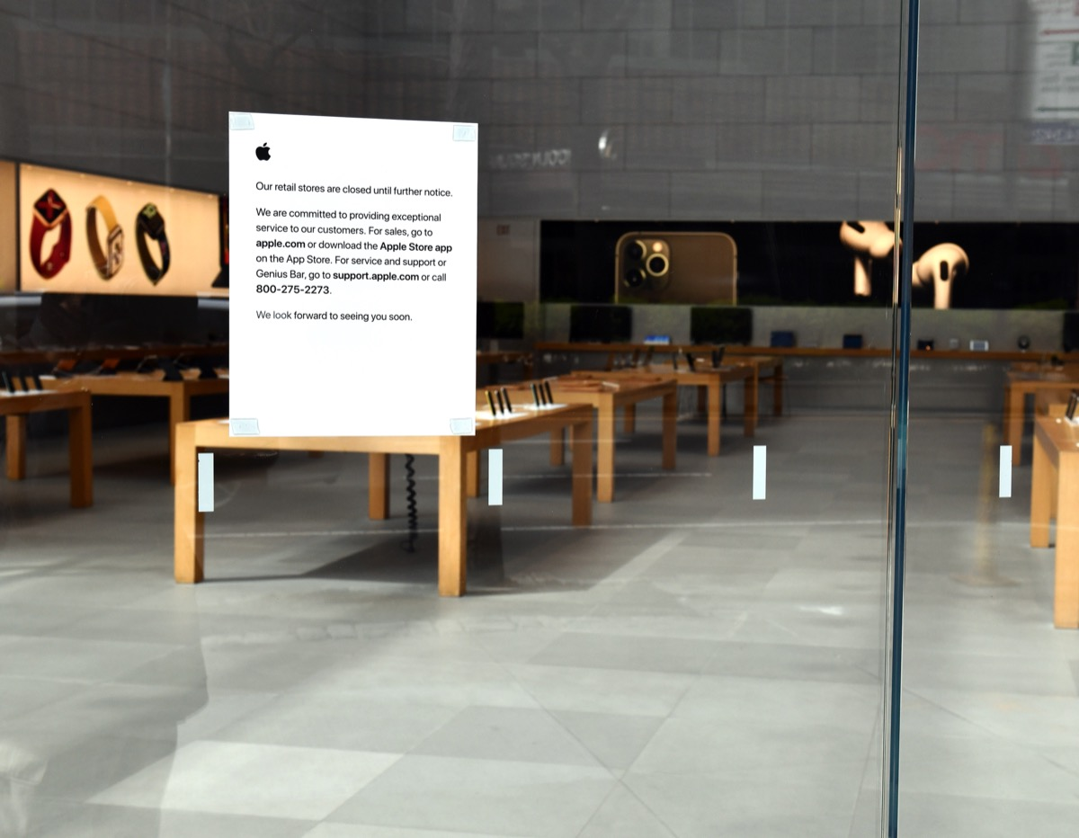 apple store with closed sign in window