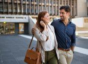 A heterosexual couple walking down the street