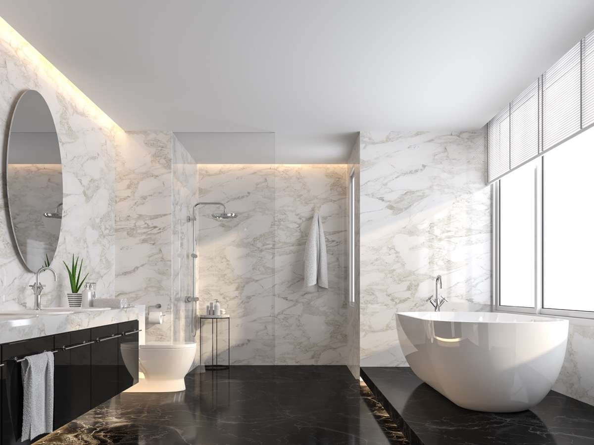 a luxury bathroom with a curbless shower