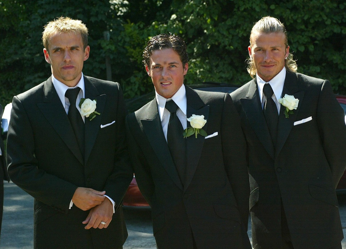 dave gardner and david beckhma posing in suits at wedding with phil neville