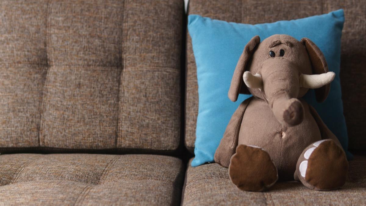 elephant stuffed animal on couch