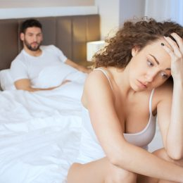 Couple fighting in bed