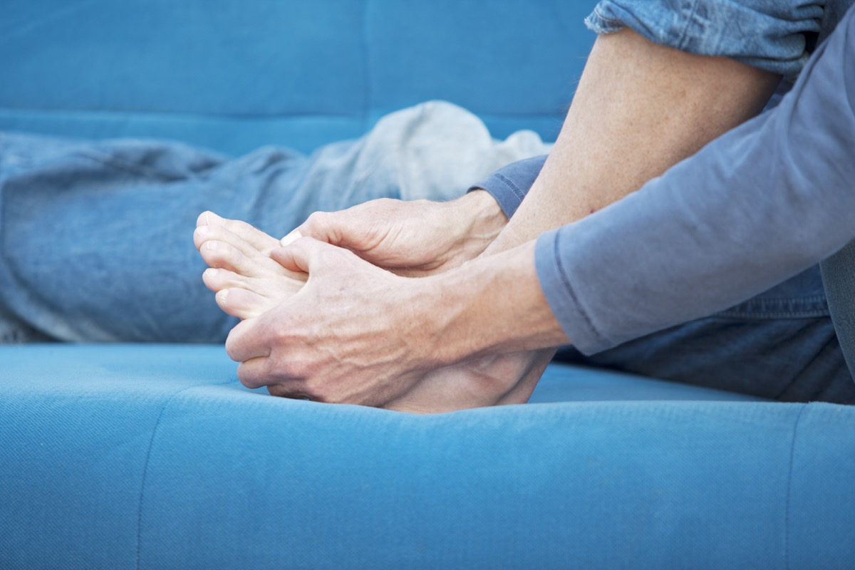 """""""A male person, having gout related pain in his metatarsophalangeal joint. XXL size image."""""""