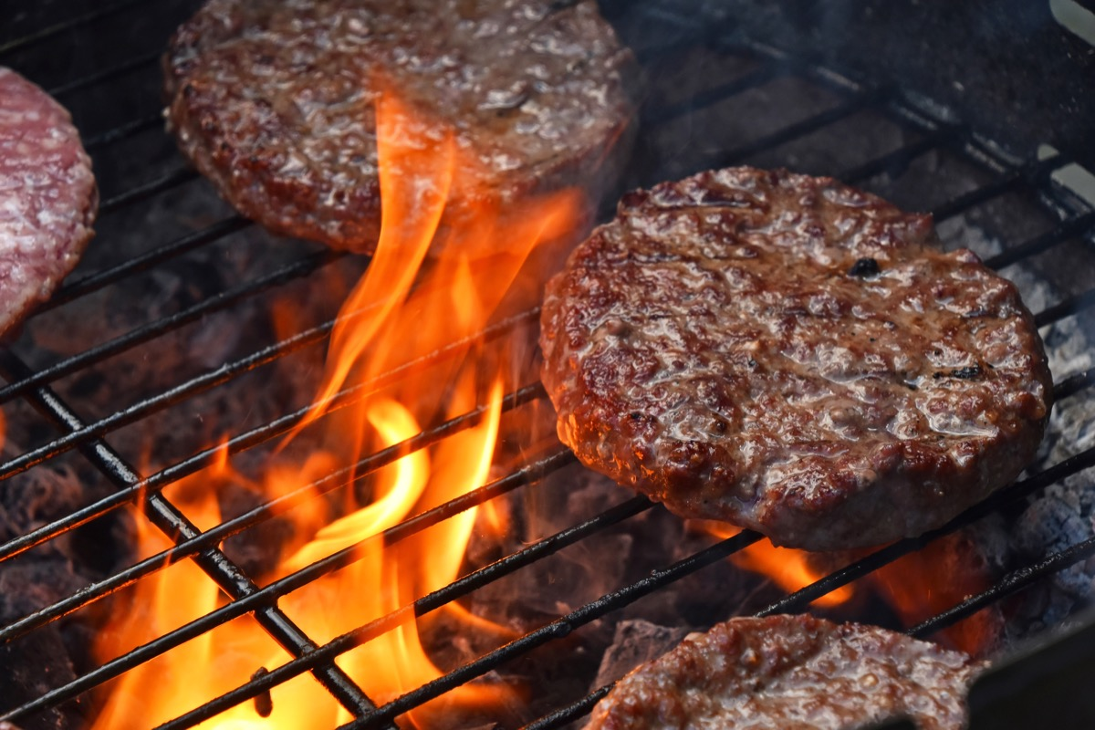 beef or port burgers on grill, fire, juicy burgers
