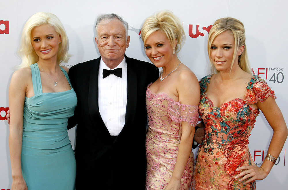 Holly Madison, Hugh Hefner, Bridget Marquardt, and Kendra Wilkinson at an event in Hollywood