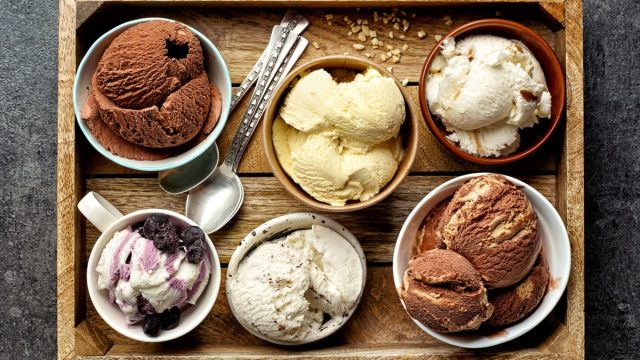 bowls of ice cream on wooden tray