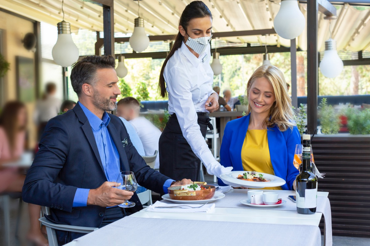 couple dining indoors during Covid pandemic