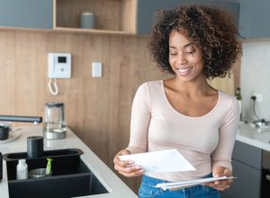 woman at home checking her mail and looking very happy – lifestyle concepts
