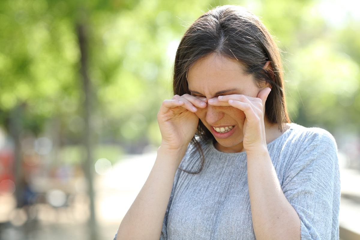 Woman itching her eyes