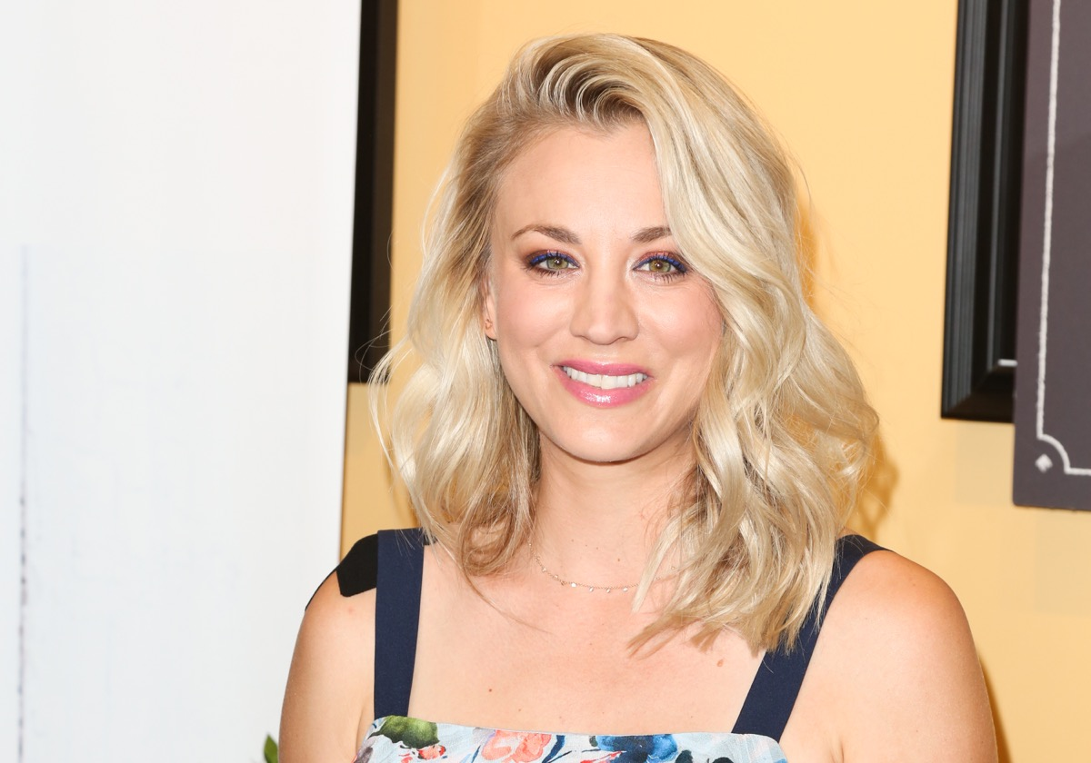 kaley cuoco smiling in tank dress on red carpet