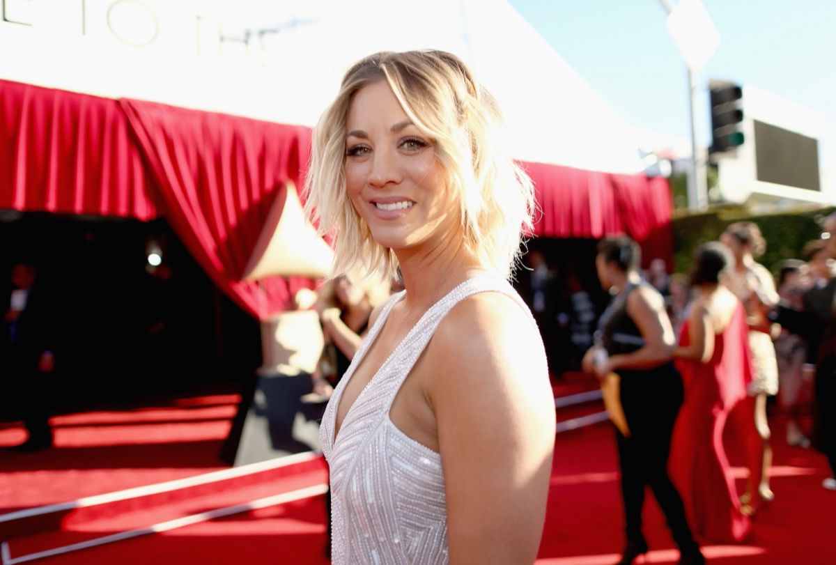 kaley cuoco in white beaded dress on red carpet