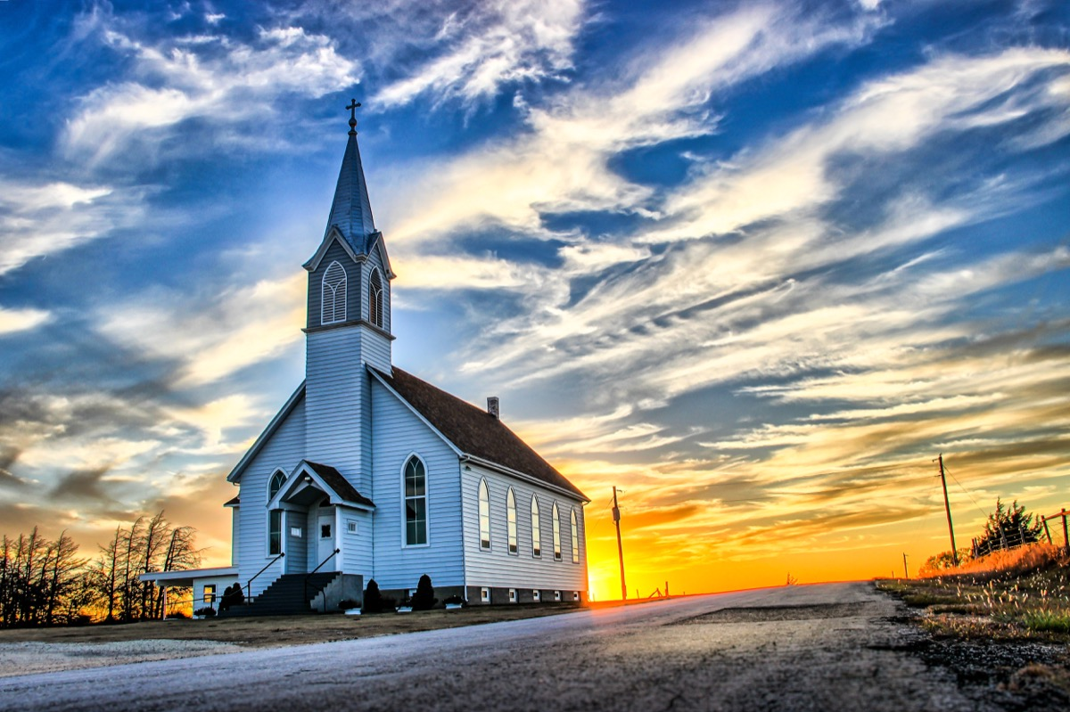 midwest prairie in kansas, church and sunset