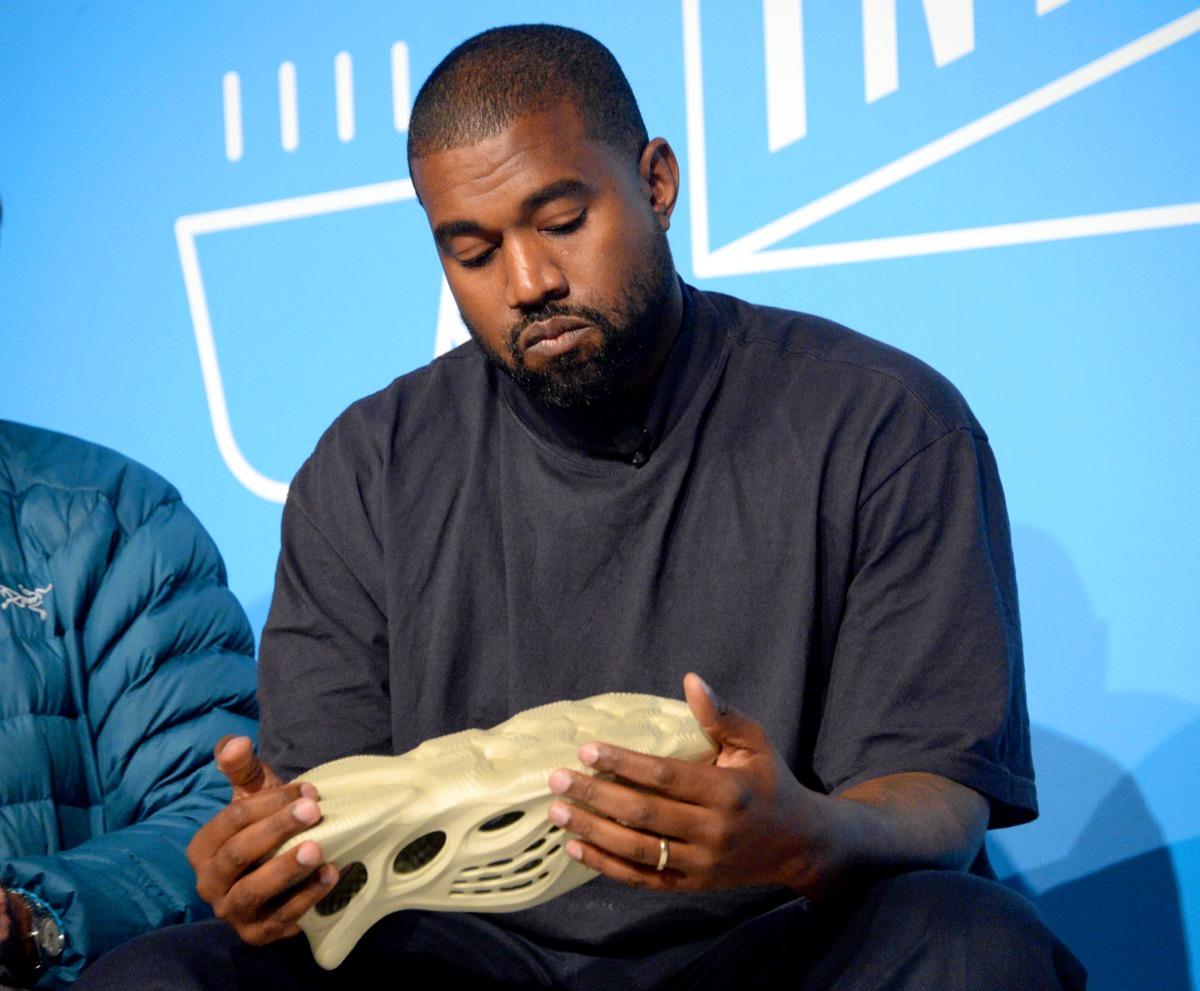 kanye west holding sneaker
