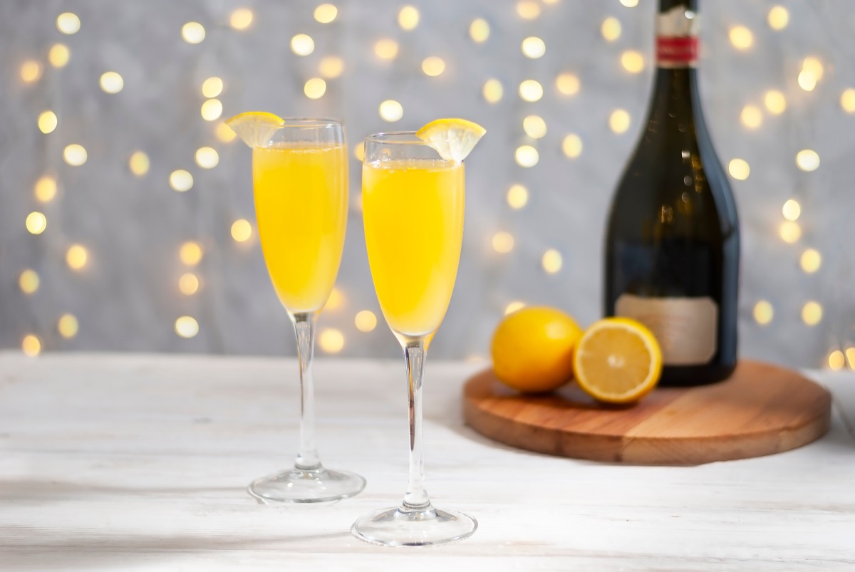 two glasses of mimosa, with lemon