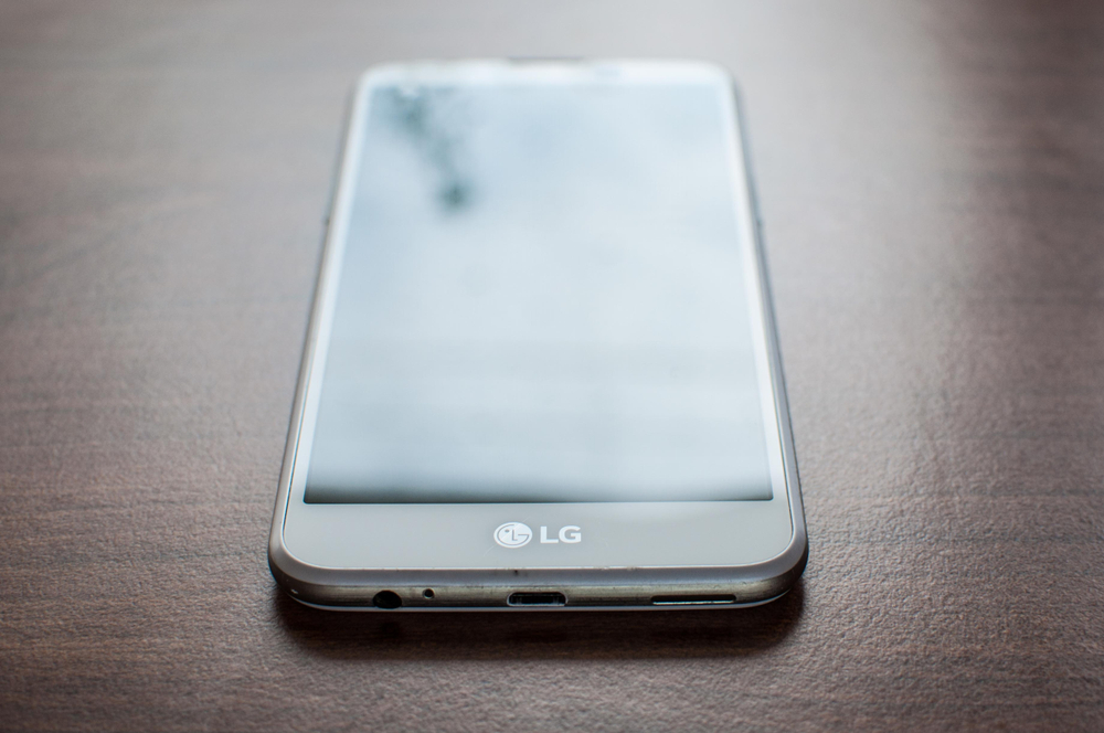 An LG mobile phone resting on a tabletop