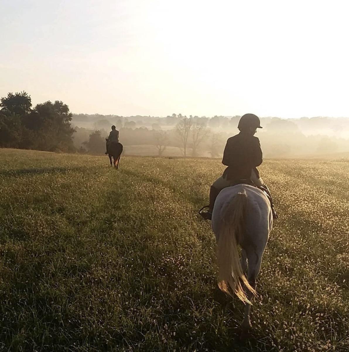 mackenzie rosman on horseback riding across a field