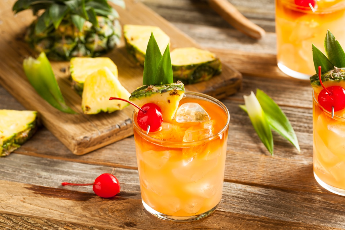mai tai cocktail with cherry, in a glass on wooden table