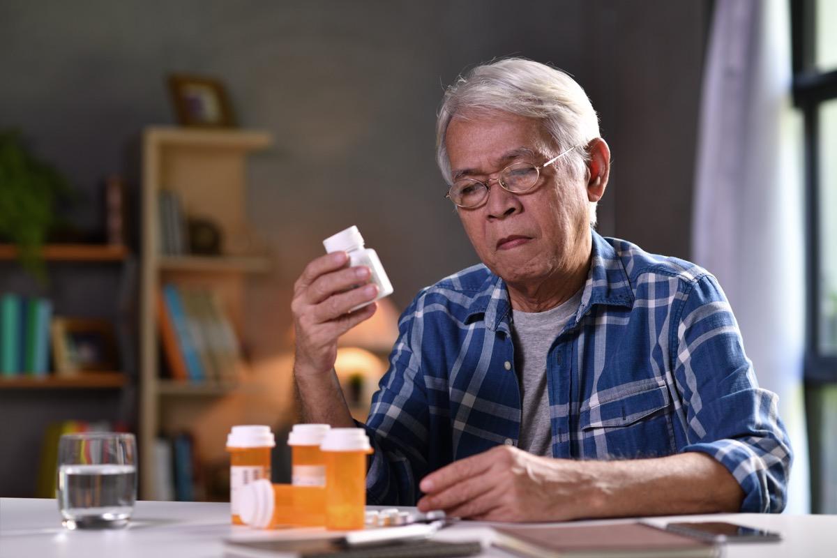 senior man with his medicine bottles
