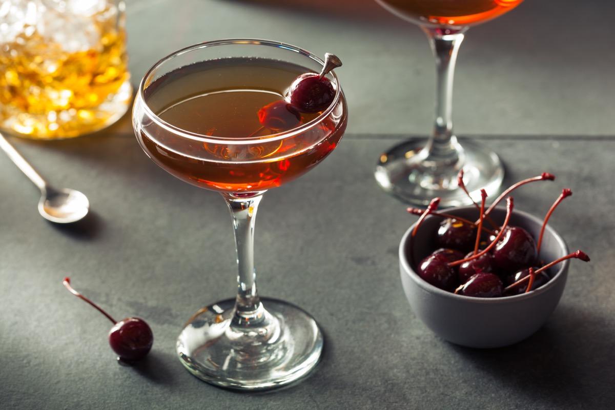 manhattan cocktail with cherries