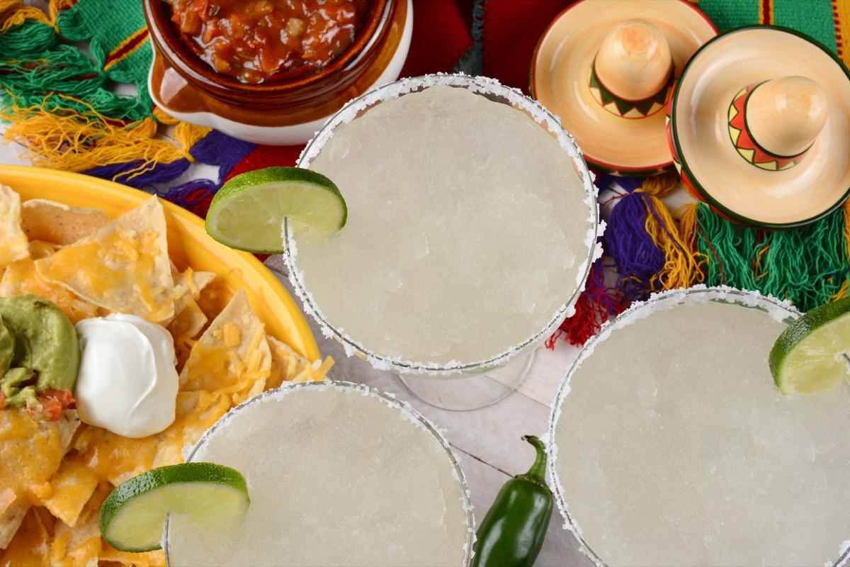 margarita cocktail, salt on glass rim, chips and salsa