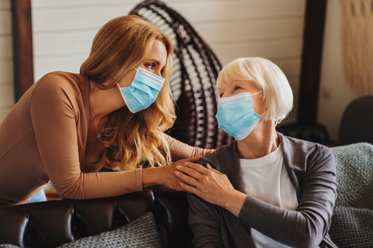 Woman and grandma wearing masks inside home
