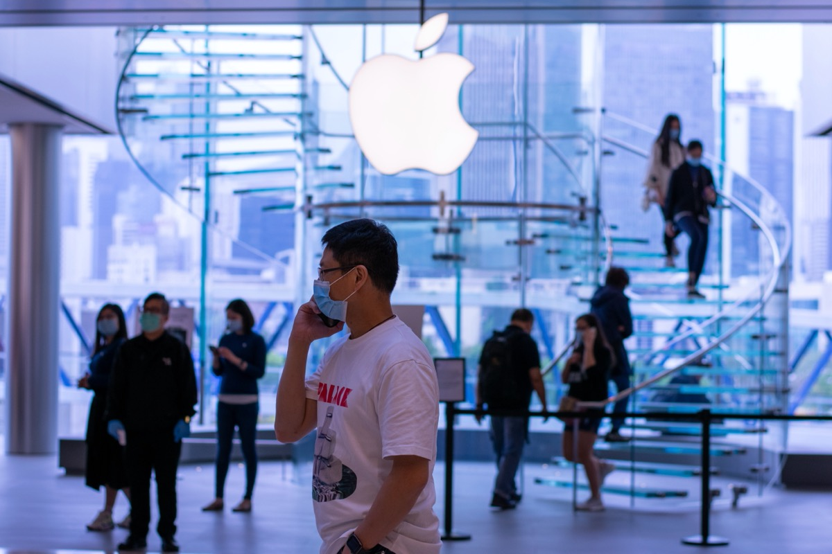 shoppers wearing face masks in apple store