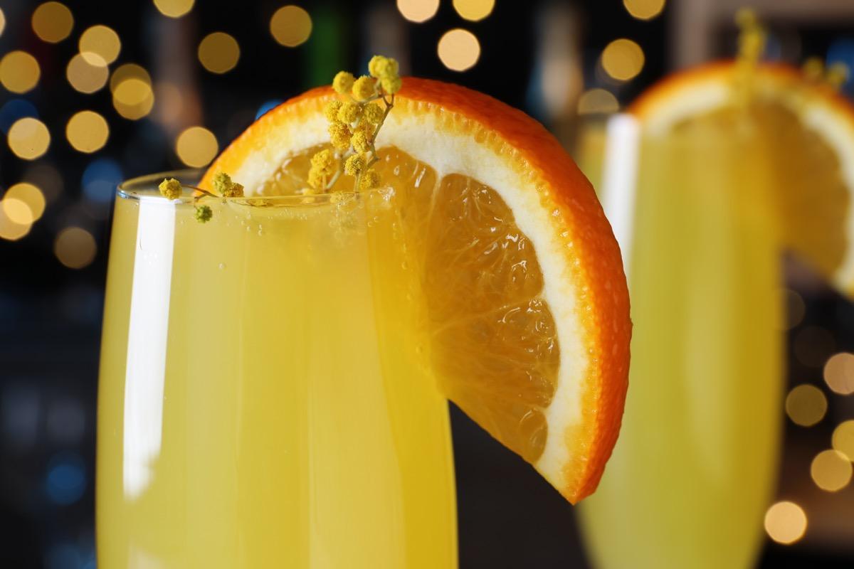 closeup mimosa cocktail with garnish