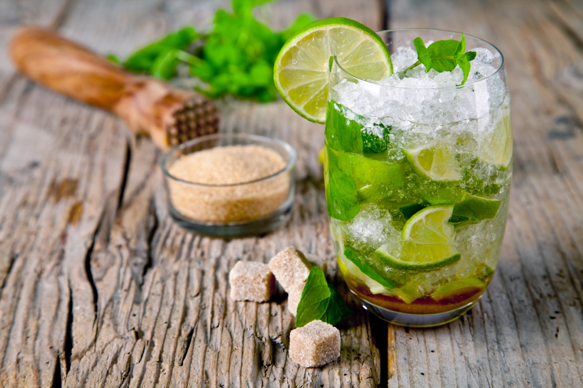 mojito in glass, with ice, sugar and lime