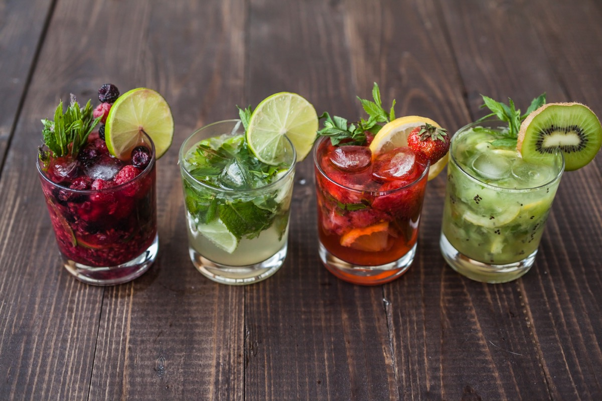mix of mojitos, with different fruits on table