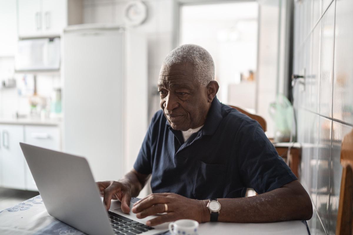 Senior man working at laptop