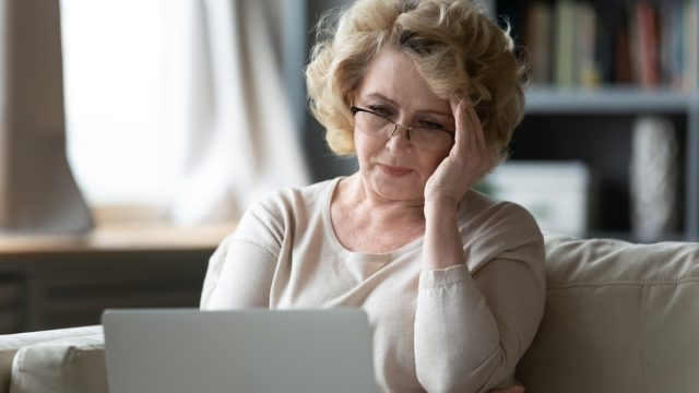 Older woman tressed on computer