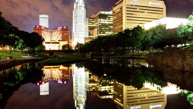 The skyline of Omaha, Nebraska reflecting off the Missouri River