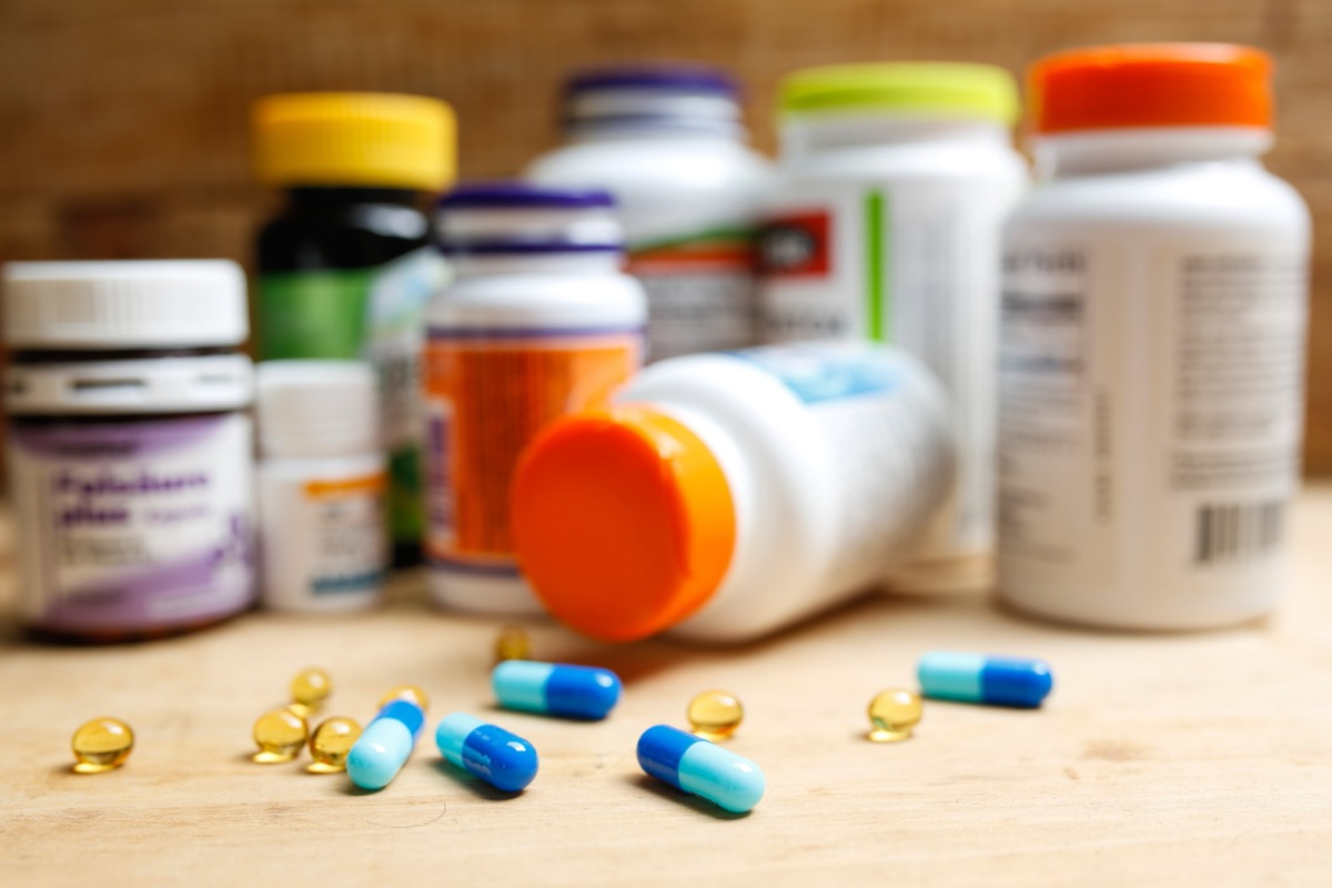 pill bottles and loose pills on counter