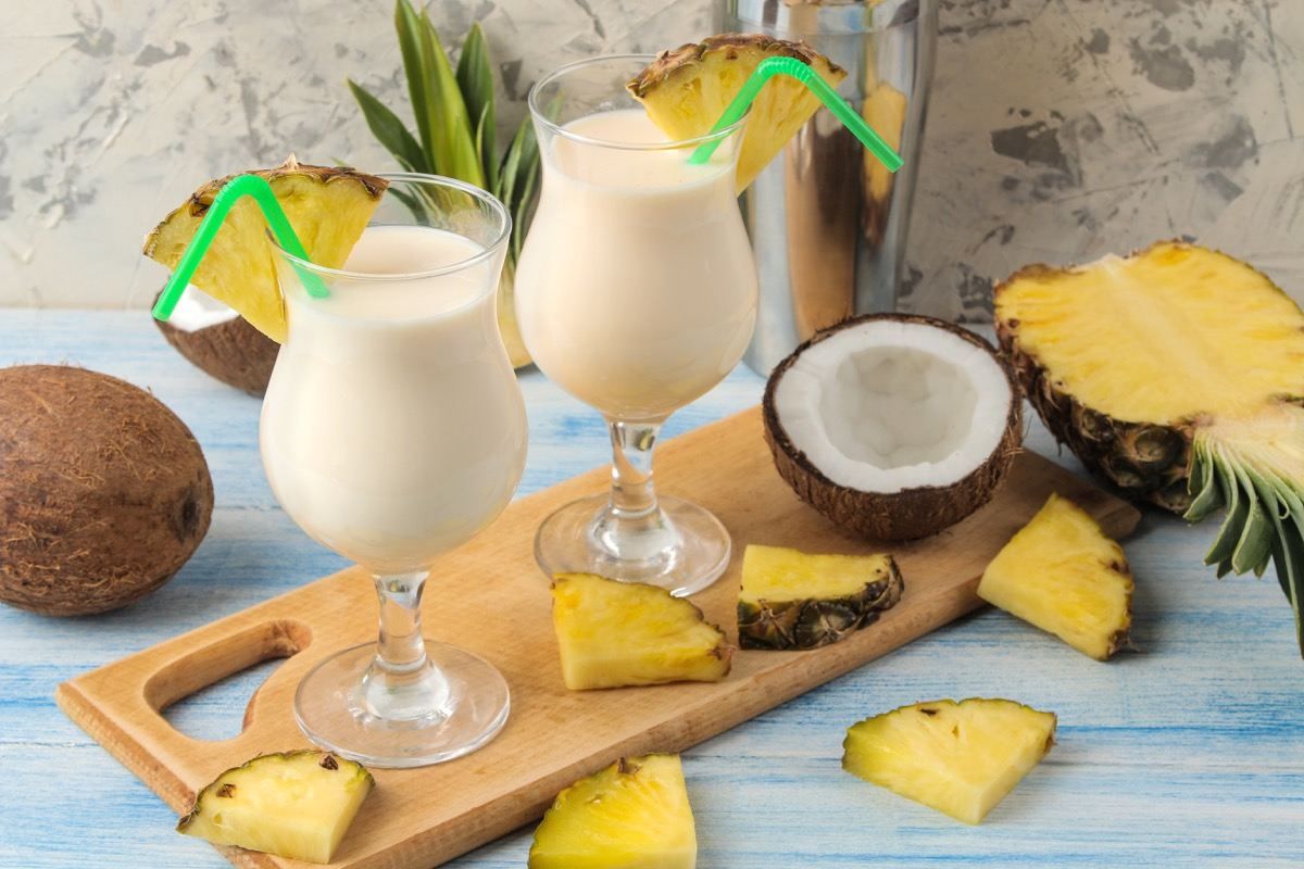 pina colada in glasses with green straws