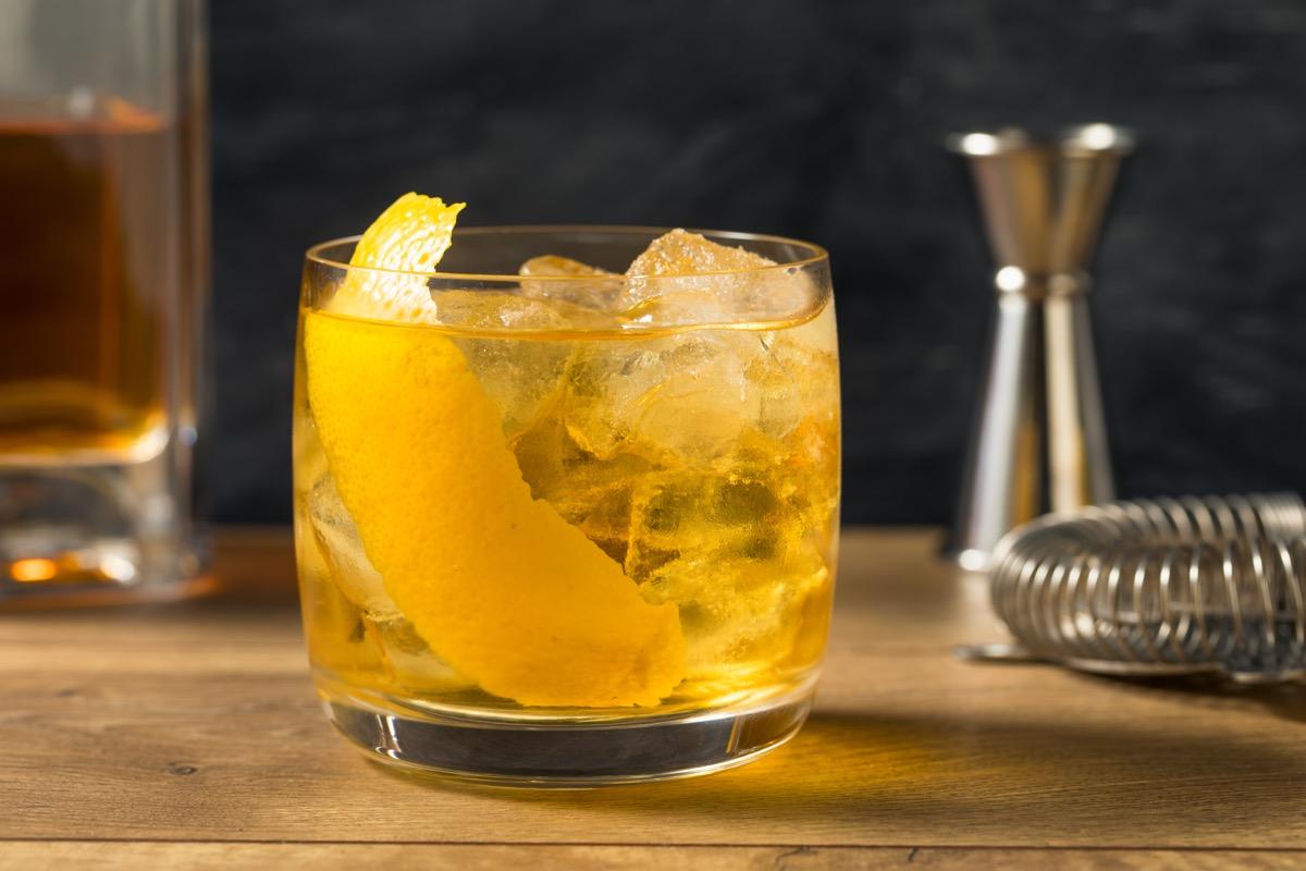 rusty nail cocktail with lemon garnish