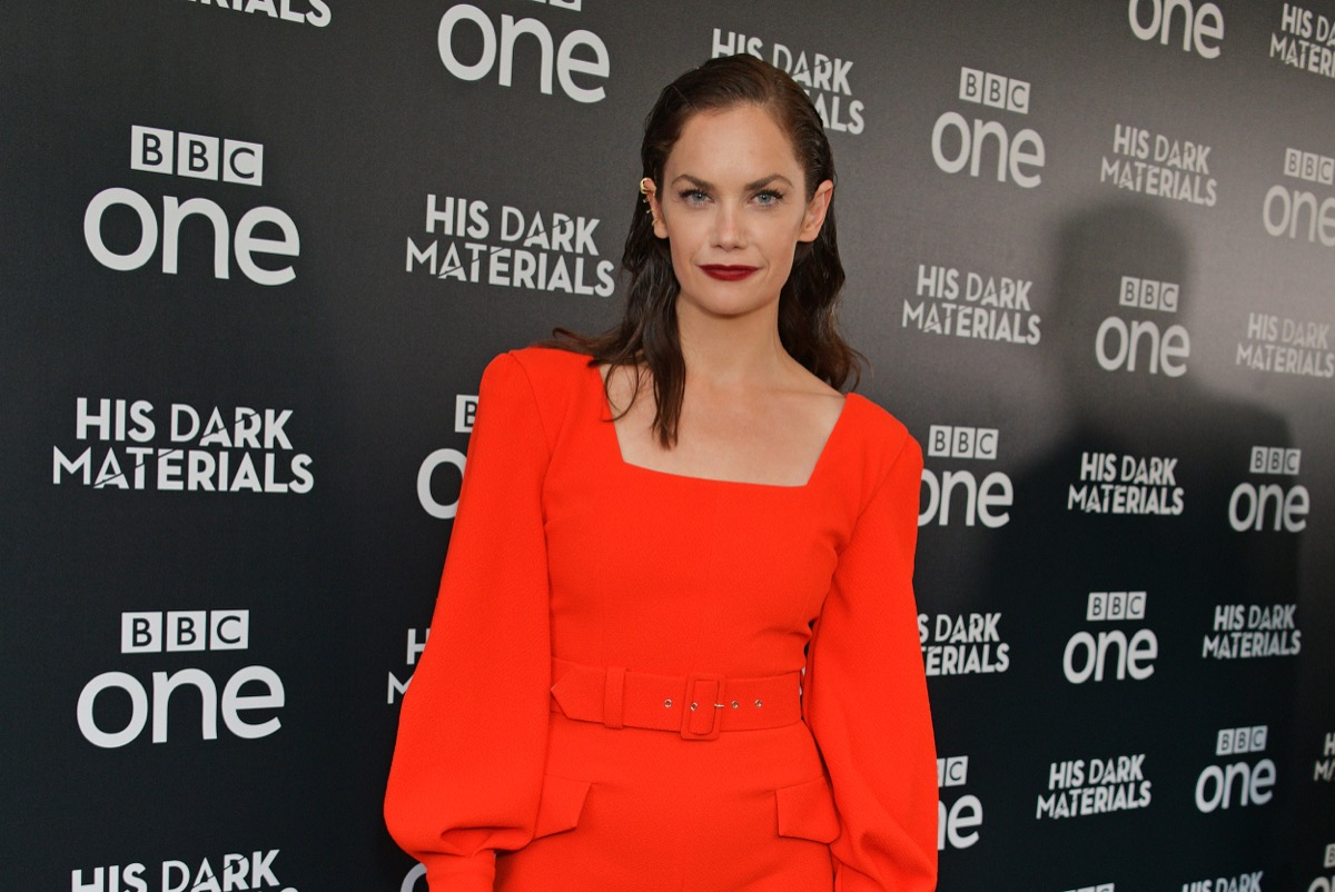 ruth wilson in red dress with square neckline on red carpet