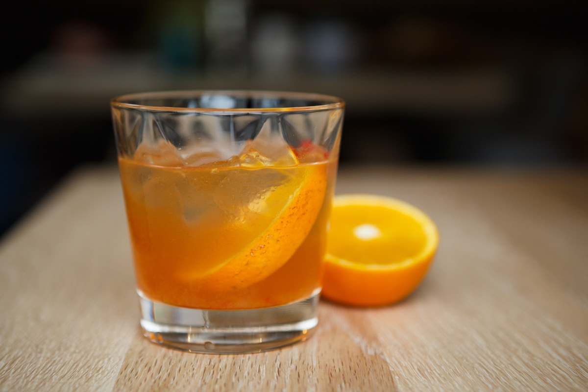screwdriver cocktail with orange on table