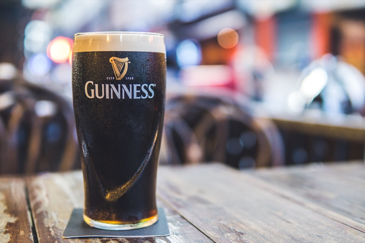 draft guinness beer in pint glass on table