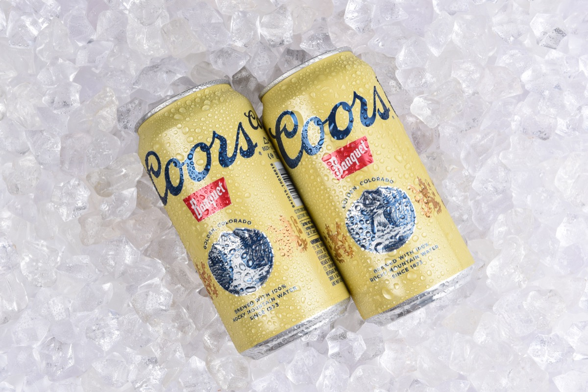 Two cans of coors banquet on ice