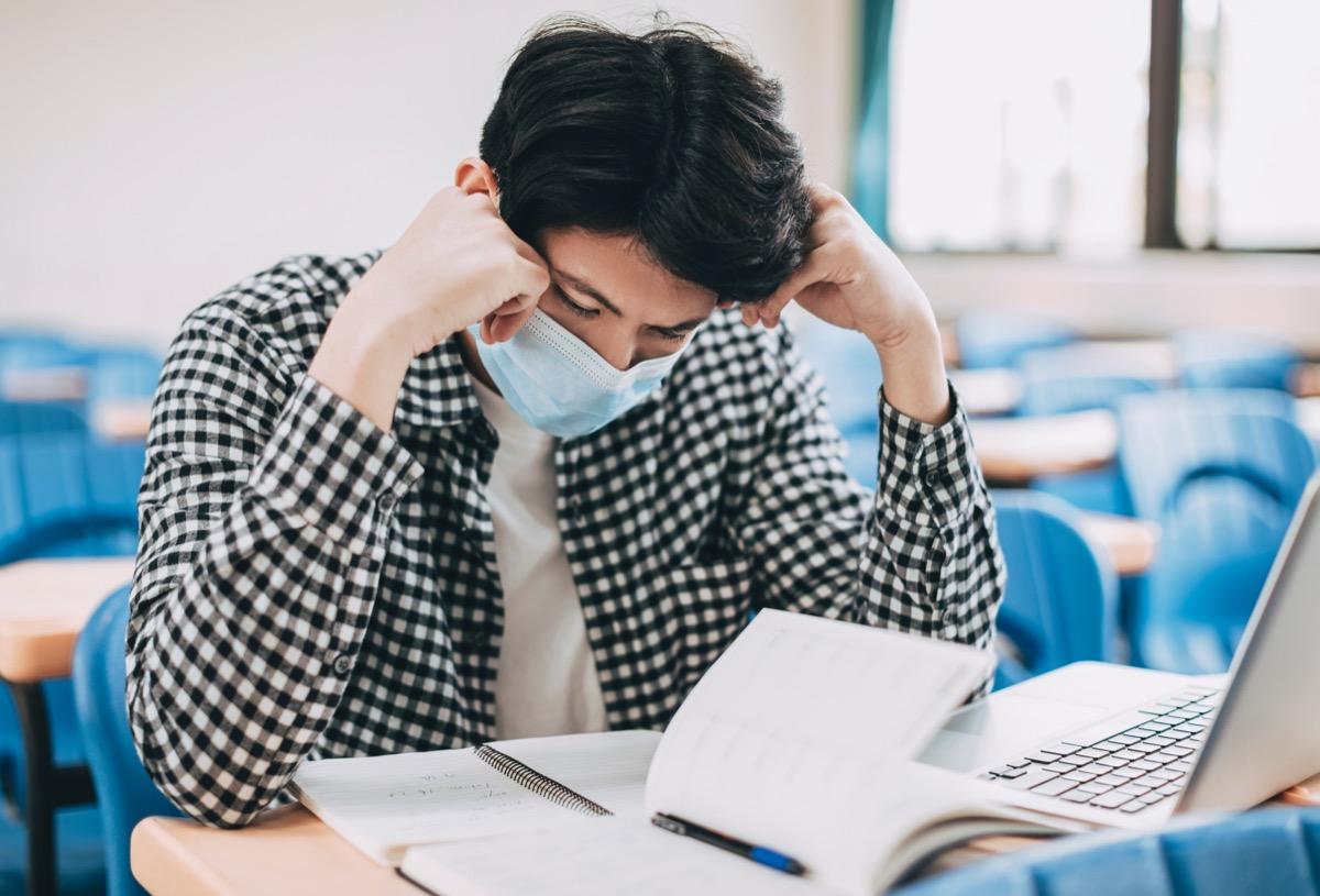 stressed college student near books