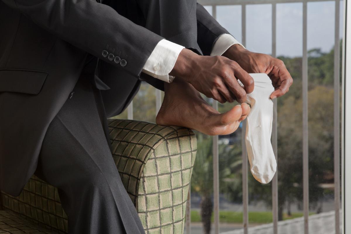 Businessman getting dressed