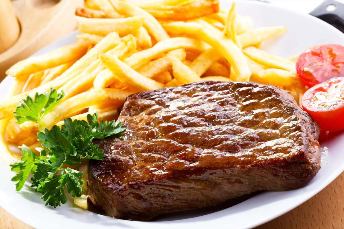 grilled steak and fries in a plate