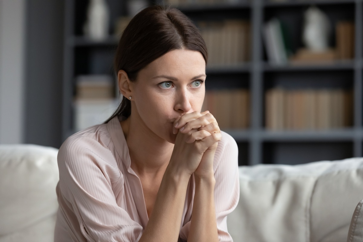 Woman stressed on the couch