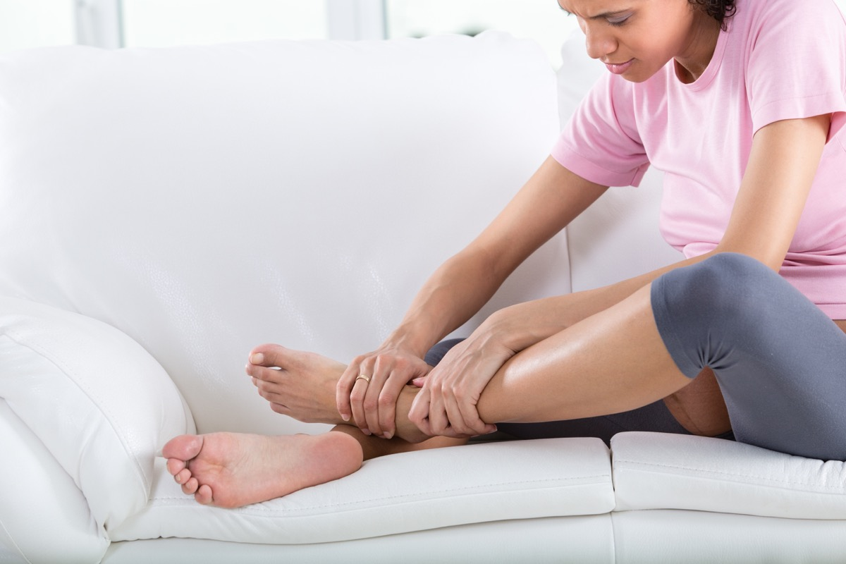 Pregnant woman with swollen feet and leg pain.