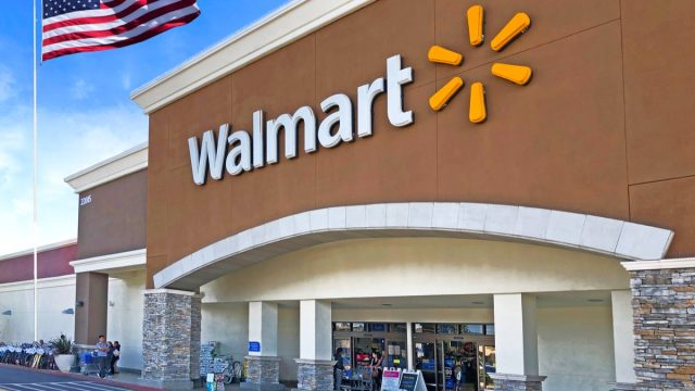 walmart exterior entrance with american flag flying nearby