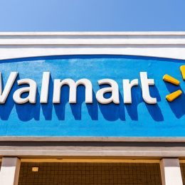The exterior sign of a Walmart location with a blue background