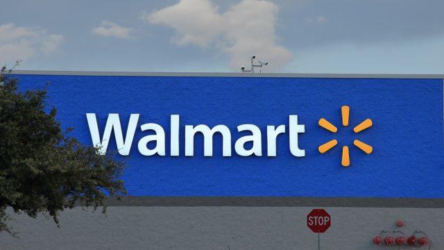 walmart store sign with sunburst logo