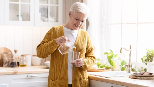 Woman pouring glass of water