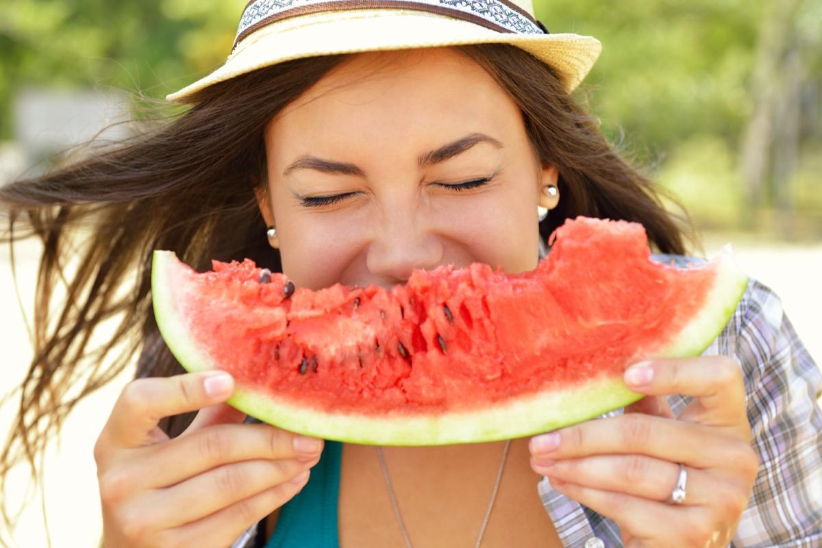 woman eating watermelon, watermelon seeds outside